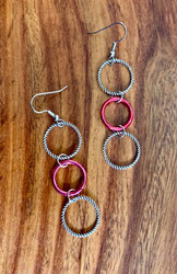 """4.00 resell for 12.00 or more 3 ring drop earrings, pewter and bright pink. Surgical steel ear wires 2 3/4""""  Style #3RDEP032719"""