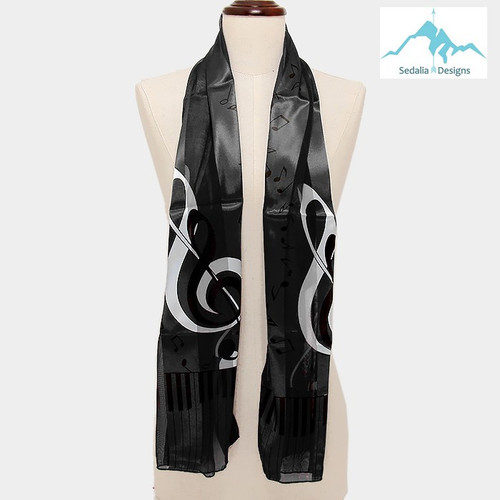 "BE SURE TO PUT ""SCARF"" IN THE SEARCH....WE HAVE DOZENS TO CHOOSE FROM STARTING AT 6.00 AND EACH GIVES BACK! **This purchase will also donate 1 scarf with earrings to a cancer patient**  Only at Website 12.00  resell for 24.00 or more  Black Music Scarf  • Color : Black • Theme : Music  • Size : 13.5"" X 60"" • Material : 100% Polyester Style #BMS040419"