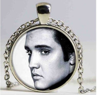 "resell for 15.00 or more Elvis Presley Black White Pendant Necklace. 20"" Silver tone chain plus ext Style #EPBWN040519"