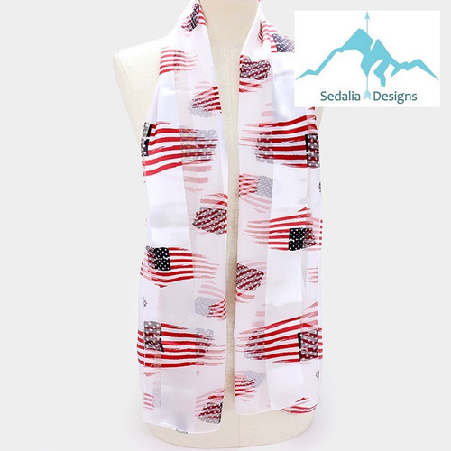 """BE SURE TO PUT """"SCARF"""" IN THE SEARCH....WE HAVE DOZENS TO CHOOSE FROM STARTING AT 6.00 AND EACH GIVES BACK! **This purchase will also donate 1 scarf with earrings to a cancer patient**   resell for 36.00 or more Flag Scarf White Background • Color : White • Theme : Flag, Patriotic  • Size : 14"""" X 60"""" • Material : 100% Polyester Style #FSW040619"""