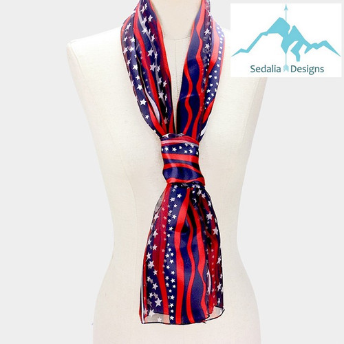"""BE SURE TO PUT """"SCARF"""" IN THE SEARCH....WE HAVE DOZENS TO CHOOSE FROM STARTING AT 6.00 AND EACH GIVES BACK! **This purchase will also donate 1 scarf with earrings to a cancer patient**  resell for 36.00 or more Patriotic Scarf / Red White Blue/ USA • Color : Navy • Theme : Flag, Patriotic  • -Size : 13"""" X 60"""" • Material : 100% Polyester Style #PFS040619"""