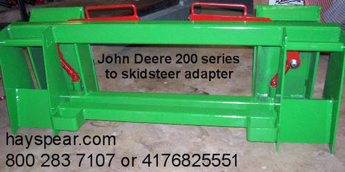 "JD 240, 245, 260 & 265 to Skid Steer Attachments Adapter  Two crossbar design keeps the face of thee latch boxes in line and keeps them from twisting and going out of alignment. Latch box sides are 1/2"" thick and are made from grade 50 plate for added strength. The latching pins are designed so that when the latches are closed the springs are bottomed out so that the pins cannot come unlatched. Bushing for pins Grease Zerk in both latching pin tubes Couples the two different Quick hitches as close as is physically possible for maintaining maximum lifting capacity. Quick attach adapters are also available for tractor loaders with pin on buckets to convert them to quick attach."