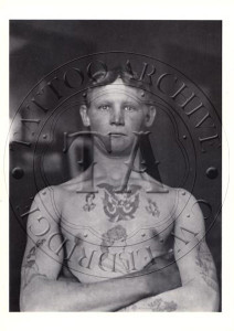 B-W photo of tattooed man listed as a stowaway from Germany, 1911. Greeting card. 5 x 7