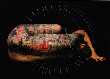 Color card showing Nolan's tattooing on Peggi Schwartz, photo by Richard Todd. 5 x 7
