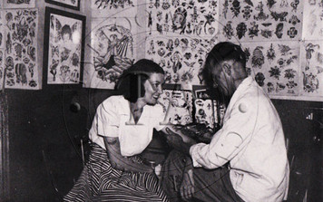 Black & White card showing the Ashwell's in their tattoo shop, Harrisburg, PA. c 1940s. 3 x 5