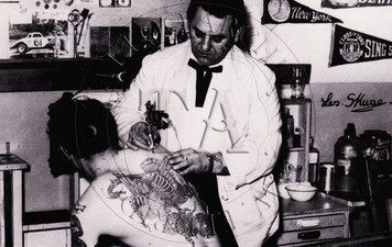 Tattoo History Series #14 shows Les tattooing his son Bill, c 1950s. Black & White card. 3 x 5