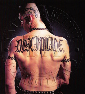 """""""Discipline"""" as seen tattooed on the back of Larry Law. Color. 5 x 6"""
