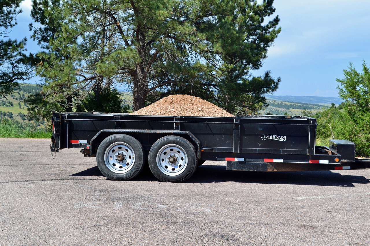 Titan Dump trailer carrying over 7 tons of gravel on Boar Evron rims.