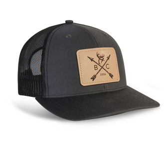 Color: Charcoal/Black Tan leather patch with engraved design  Richardson 112 Cotton twill front panels and visor with mesh back panels ProCrown with buckram-fused front panels and ProStitching Pre-curved PE visor with eight rows of stitching. Snapback closure