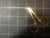 Left view photo of Storz N1705 86 House Oval Cup Forceps Angled Left