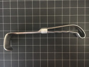 Left side photo of Reed & Barton USN Kelly Retractor