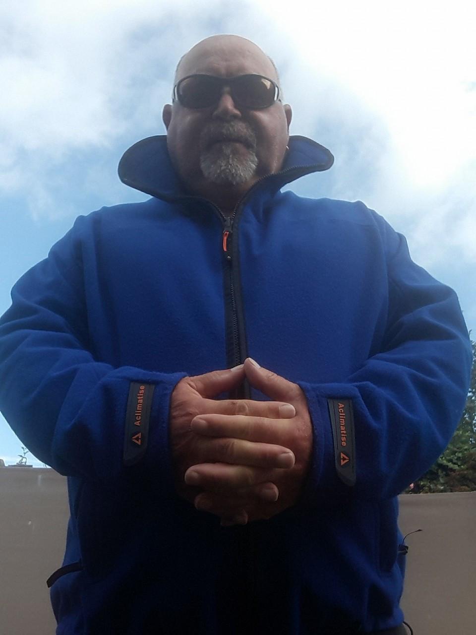 Tony King Angling ambassador, wearing the Highlander Fleece in Royal