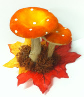 Orange toadstools on hairclips