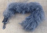 Grey clip on tail in long fur