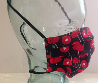 Red poppies on black background face mask side view