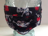 Skulls and roses on black fabric face mask