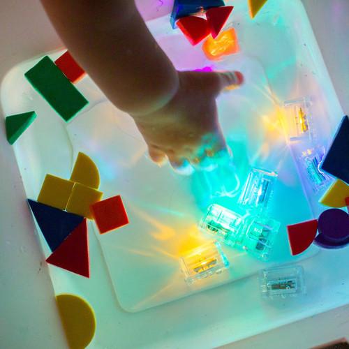 Glo Pal cubes in sensory water bin