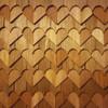 Sample of heart shaped cedar shingles on dollhouse close up