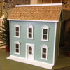 Simple dollhouse shown with heart shaped cedar shingles