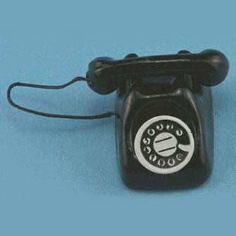 Image of black rotary dial telephone on blue background