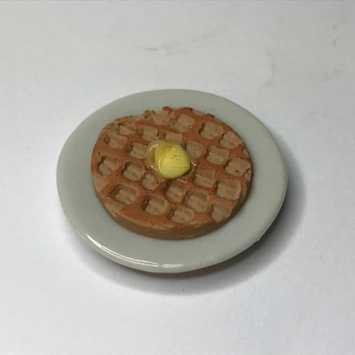 Waffle on white ceramic dish