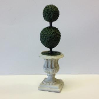 One double ball topiary in gray urn.