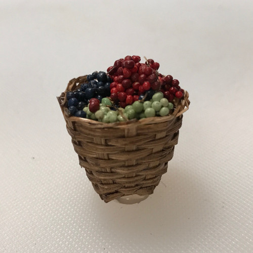 Small basket of grapes standing.
