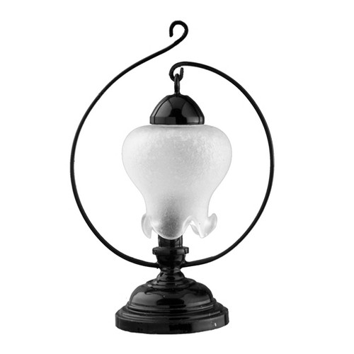 Hanging frosted tulip shade in black curled base table lamp.