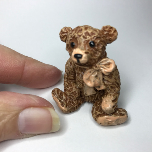 Itty bitty brown bear with big bow