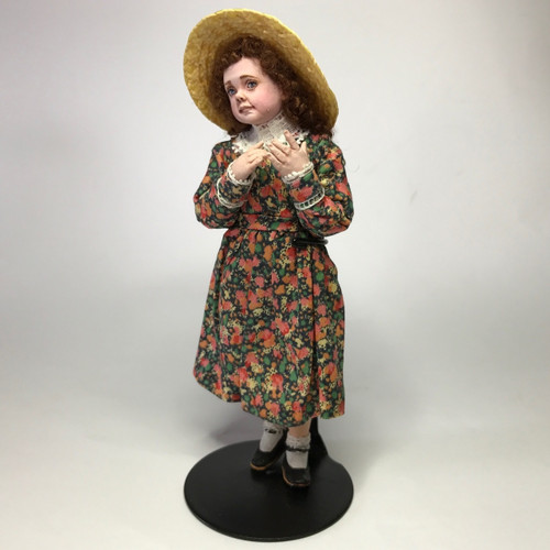 Front left view of little girl doll