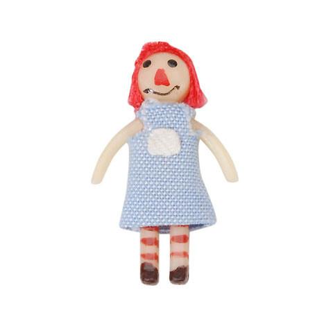 Dollhouse rag doll toy.
