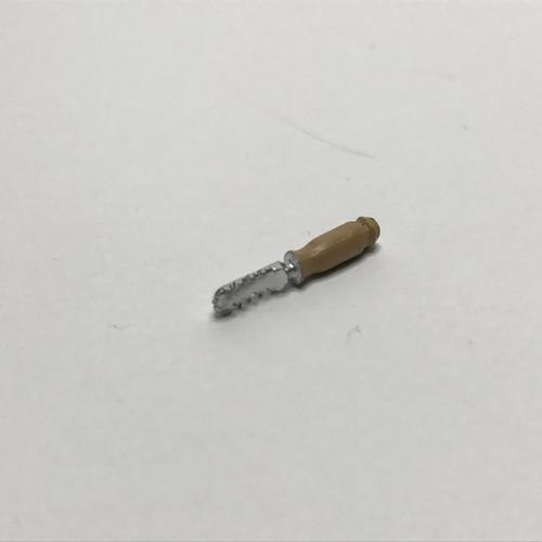 Miniature fish scaling tool