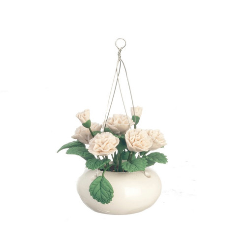 White ceramic hanging pot filled with white carnations