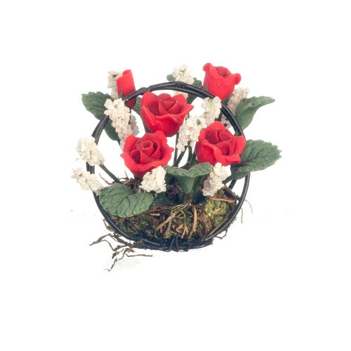 Red roses with with accent flowers and green leaves in black wire basket