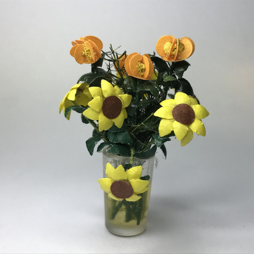 Brown Eyed Susan and peach flowers in glass vase
