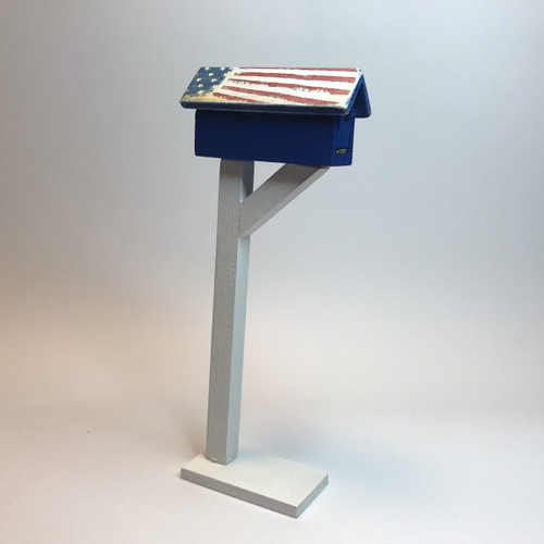 Patriotic mailbox with distressed flag roof