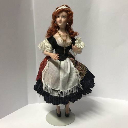 Miniature porcelain gypsy doll