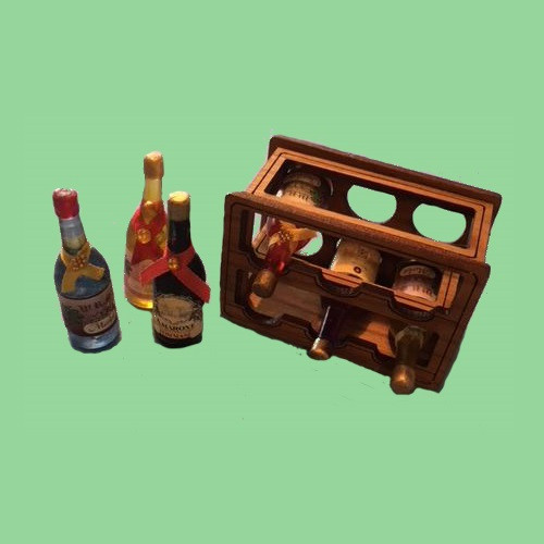 Image of assembled wine rack kit and 3 extra wine bottles