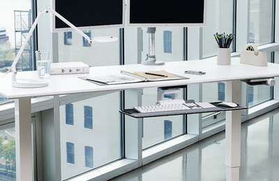 Humanscale Float Sit-Stand Adjustable Height Table Shown with optional Humanscale Monitor Arm