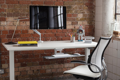 Humanscale Float Sit-Stand Adjustable Height Table in office setting