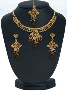 Intricate designed set with pear shaped Brown & clear stones set against gold background-JCB128