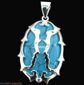 Silver wrapped Oval shaped Turquoise pendant jewellery