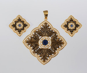 Antique Gold Background Floral Design with American Diamonds and Sapphire Blue stone Pendant