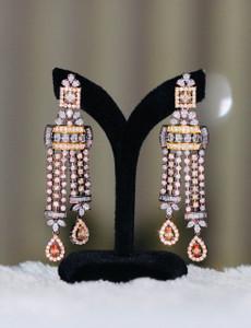 Long drop earrings in Topaz