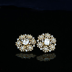 Cubic zirconia stud earrings | Gold Tone earrings in floral designs.