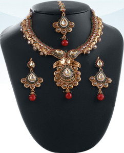 Fabulous Indian bridal polki jewelry set hand crafted in a gold background with Emerald and Ruby polki stones -04PLKA04