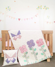 A sweet Quilt and Cushion Duo to make to celebrate a new arrival or perfect for the little lady.