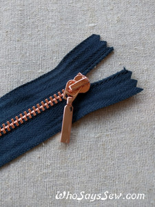 Shiny Rose Gold Metal Teeth Zipper 60cm. Size 3 Closed Ended. Distinctive Pull Design. Navy Tape. Nickel Free