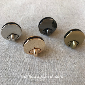 Small Round Twist/Turn Lock inGunmetal, Brushed Antique Brass. Screw Back. 2.6cm.