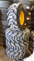 (4- Tires with Wheels) John Deere model skid-steer with tire size 14-17.5 14175